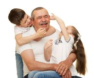Grandfather and grandchildren portrait studio shoot. Grandfather and grandchildren portrait on white royalty free stock photo