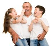 Grandfather and grandchildren portrait. On white stock photography