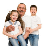 Grandfather and grandchildren portrait. On white stock photography