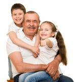 Grandfather and grandchildren portrait Royalty Free Stock Image