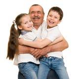 Grandfather and grandchildren portrait. On white stock image