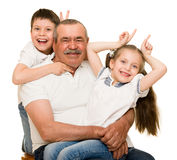 Grandfather and grandchildren portrait. On white stock photo