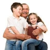 Grandfather and grandchildren portrait Royalty Free Stock Photos