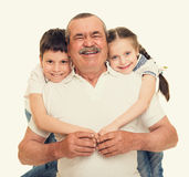 Grandfather and grandchildren portrait. Yellow toned royalty free stock photography