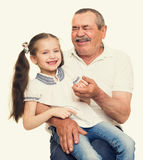 Grandfather and grandchildren portrait. Yellow toned stock photography