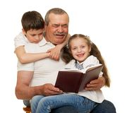 Grandfather and grandchildren read book. On white royalty free stock images