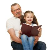 Grandfather and grandchildren read book. On white stock photography