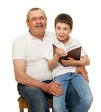 Grandfather and grandchildren read book. On white royalty free stock photo
