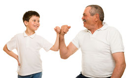 Grandfather and grandchildren show muscle hand Stock Images