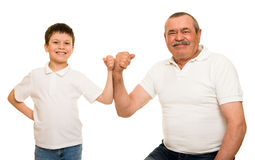 Grandfather and grandchildren show muscle hands Stock Photos