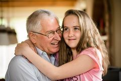 Grandfather and granddaghter hug Stock Photos