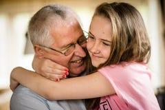 Grandfather and granddaghter hug Royalty Free Stock Image
