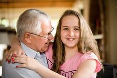 Grandfather and granddaghter hug Royalty Free Stock Photos
