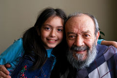 Grandfather and granddaughter. Smiles to camera royalty free stock images