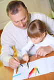 Grandfather and granddaughter Stock Image