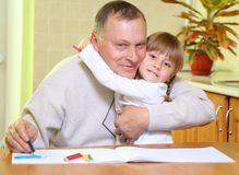Grandfather and granddaughter. At  home draw with pencils Royalty Free Stock Images