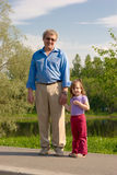Grandfather and granddaughter Royalty Free Stock Photo