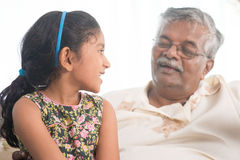 Grandfather and granddaughter communicate Royalty Free Stock Photo