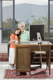 Grandfather and granddaughter with computer Stock Photography