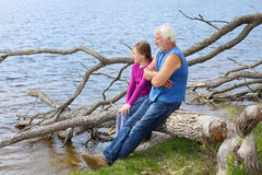 Grandfather and granddaughter. Are dreaming in nature Royalty Free Stock Photo