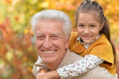 Grandfather and granddaughter having fun Royalty Free Stock Photo