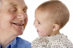 Grandfather and granddaughter holding hands Stock Photos