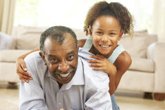 Grandfather And Granddaughter At Home Royalty Free Stock Images