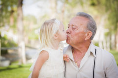 Grandfather and Granddaughter Kissing At The Park Stock Image