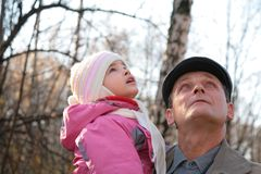 Grandfather with  granddaughter look upward Stock Images