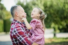 grandfather with granddaughter. Multi generation family enjoying in the park. royalty free stock photo
