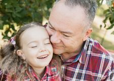 grandfather with granddaughter. Multi generation family enjoying in the park royalty free stock photo
