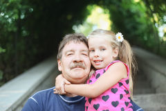 Grandfather with granddaughter outdoor Stock Photography