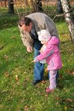 Grandfather with  granddaughter outdoor Stock Image