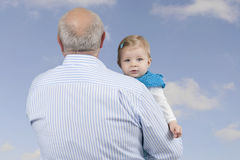 Grandfather with granddaughter , outdoors Royalty Free Stock Images