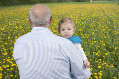 Grandfather with granddaughter , outdoors Royalty Free Stock Photography