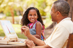 Grandfather With Granddaughter Outdoors Painting Landscape Stock Photo
