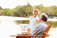 Grandfather With Granddaughter Outdoors Painting Landscape Royalty Free Stock Image