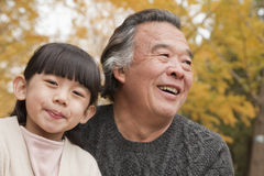 Grandfather and granddaughter in park Stock Images