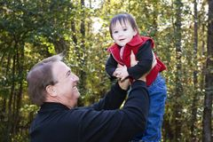 Grandfather and granddaughter playing royalty free stock photography