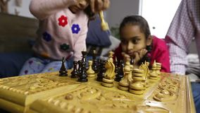 Human hands moving chess pieces on chessboard stock video footage