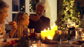 Grandfather and granddaughter playing at Christmas dinner table. Grandfather and granddaughter playing at Christman dinner table. Family having thanksgiving stock video footage
