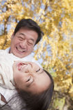 Grandfather and Granddaughter Playing in the Park, Laughing, in Autumn Stock Image