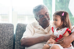 Grandfather and granddaughter Stock Photography