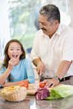 Grandfather And Granddaughter Preparing meal. Mealtime Together Royalty Free Stock Image