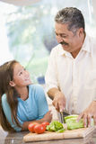Grandfather And Granddaughter Preparing meal. Mealtime Together Royalty Free Stock Photos