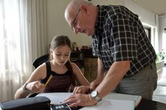 Grandfather and granddaughter, private mathematics  tutoring Stock Image