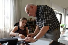 Grandfather and granddaughter, private mathematics  tutoring Royalty Free Stock Image