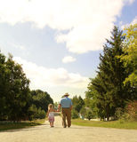 Grandfather and granddaughter are on the road Stock Photos