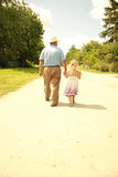 Grandfather and granddaughter are on the road Royalty Free Stock Photos