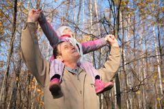 Grandfather with  granddaughter on shoulders Stock Photos